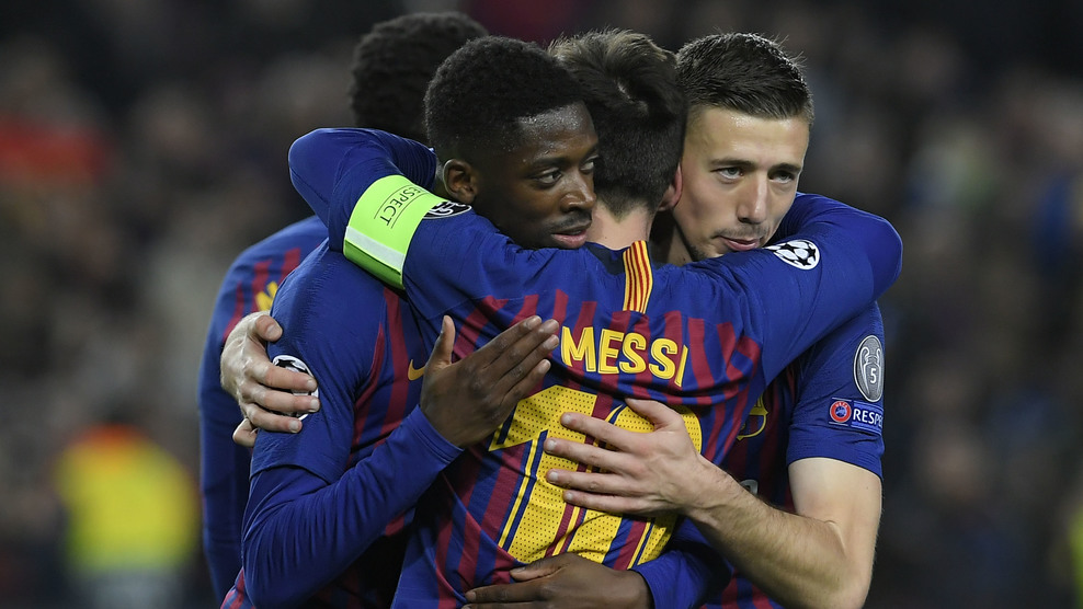 Barcelona's French forward Ousmane Dembele (L) celebrates his goal with teammates during the UEFA Champions League round of 16, second leg football match between FC Barcelona and Olympique Lyonnais at the Camp Nou stadium in Barcelona on March 13, 2019. (Photo by LLUIS GENE / AFP) (Photo credit should read LLUIS GENE/AFP/Getty Images)